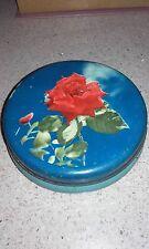 Antica scatola di latta decorazione floreale sul coperchio