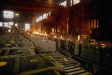 667031 Row Of Molds Filled With Steel Nova Scotia Canada A4 Photo Print