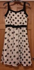 ladies dresses size medium. White with black spots. Suitable for an occasion.