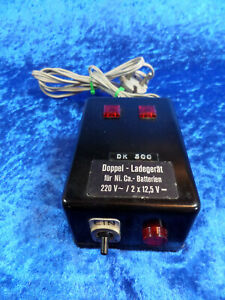 Doppel-Ladegerät für Ni. Ca. - Batterien (Accus) 220 Volt / 2x 12,5 Volt