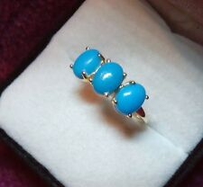 2.25 ct. Arizona Sleeping Beauty Turquoise Trilogy Ring Set In 9 kt Yellow Gold.