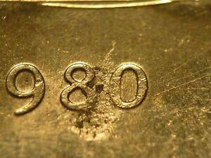 Error: Canada 1980 nickel dollar struck through grease, some grease retained