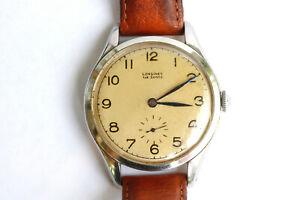 Belle et ancienne montre Longines à remontage manuel.