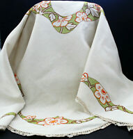 Vintage beige linen table cloth with orange embroidered flowers.