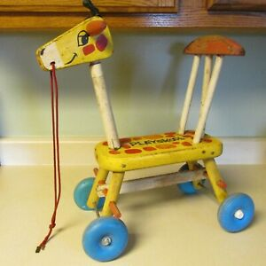 VINTAGE PLAYSKOOL GIRAFFE WOODEN RIDING TOY WITH PULL STRING PLASTIC WHEELS!