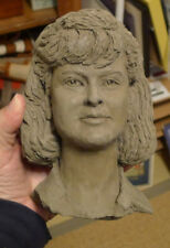 Clay Sculpture of a Girl's Head