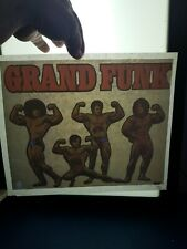 Vintage 1970s grand funk band iron t shirt transfer nos music muscle guys