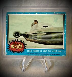 1977 STAR WARS - Luke Rushes to Save His Loved Ones - Series 1 (Blue) Card #25