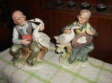 PAIR OF ORIENTAL FIGURINES & GEESE WOMAN WITH EGG BASKET MAN WITH FRUIT BASKET