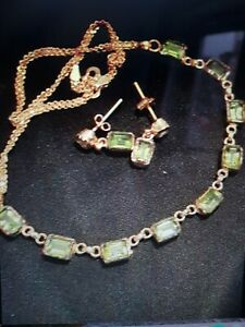 18ct gold 13ct peridot necklace and earring set.