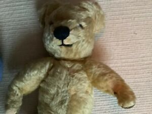 Merrythought teddy bear and blue label