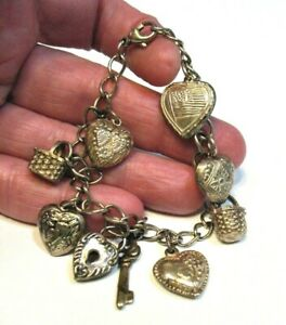 VINTAGE STERLING SILVER CHARM BRACELET PUFF HEART AND BASKET CHARMS 17.8 GRAMS