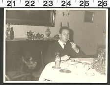 VINTAGE RPPC FUNNY PHOTO YOUNG MAN EATING WITH BLACK DOG AT THE TABLE #2518