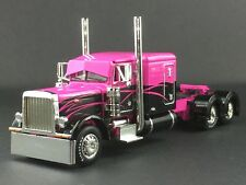 "1/64 DCP PINK/BLACK PETERBILT 379 63"" FLATTP SLEEPER"