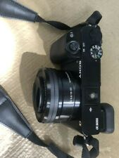 Sony A6000 24.7MP Camera with Interchangeable Len, Case and Stand, battery.