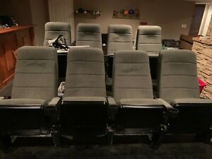 Theater Seats with cup holders on elevated platform (included). Barely used.