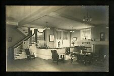 Real photo postcard RPPC Interior Hotel Lobby clock fireplace rocking chair