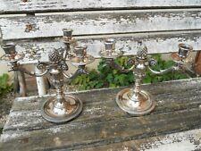 Paire de candélabre bougeoir Chrysalia métal argenté décor tète d'aigle, gland