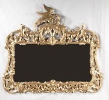 "Gilt wood mirror having phoenix surmount with pierced foliate, 38"" hi. Lot 395"