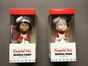SET OF TWO CAMPBELL KIDS BOBBLE HEAD COLLECTIBLE DOLLS.  ORIGINAL PACKAGING.