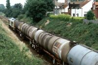 PHOTO  CLASS 60 LOCO NO 60??? AT NR LINCOLN ON OIL TANKS 1992