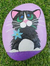 Hand Painted pebble natural stone rock art Black cat on purple with blue flower