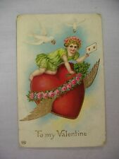 VINTAGE EMBOSSED VALENTINE'S POSTCARD CUPID ON A FLYING HEART WITH WINGS 1911