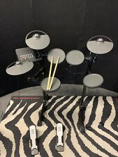 Yamaha dtx400 electronic drum set with drumsticks.