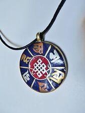 Tibetan brass/Lapis knot Mantra.  Necklace on black string. 1 1/2 inch round.