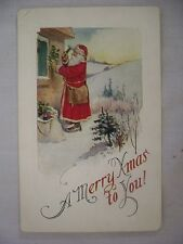 Vintage Embossed Christmas Postcard Santa Hanging Holly On House In Winter Scene