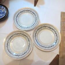 3 petites assiettes avec liseré or et bordure de fleurs noires