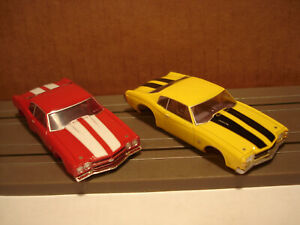2 TOMY AFX HO SCALE BODIES ONLY CHEVROLET CHEVELLE RED & YELLOW CLEAR SEE BELOW