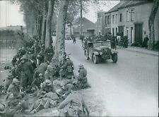 Belgian soldiers resting on the street side. - 8x10 photo