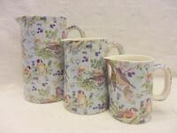 Heron Cross Pottery set of 3 jugs in British birds on blue design.