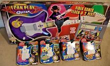 FISHER PRICE I CAN PLAY GUITAR SYSTEM W/ 5 CARTRIDGES L6356 PURPLE NEW