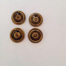 Four round neoclassic brass furniture pulls