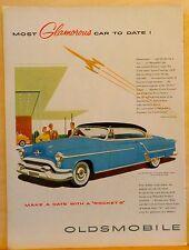 Vintage 1950's ad for Oldsmobile - blue Ninety-Eight Holiday Coupe', Glamorous