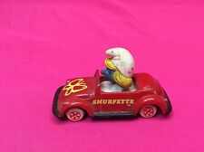 VINTAGE 1982 PEYU SMURFETTE IN DIECAST RED CAR FIGURE TOYS