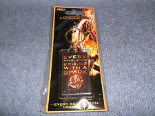 THE HUNGER GAMES CATCHING FIRE - EVERY REVOLUTION LUCITE KEYCHAIN NEW IN PACKAGE