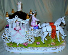 Dresden Horse Drawn Carriage with 2 Lady Passengers, Coachman and Floral Base