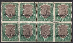 Bahrain 1933 KGV 1r chocolate & green in a block of 8 Good used. SG 12. Sc 12.