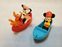 Vintage Mickey and Minnie Mouse and Pluto on two boats figurines