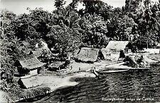 Vintage RPPC Postcard Suriname Bushnegro villiage along the Cottica River