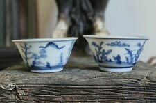 Two Shipwreck Qing Kangxi blue and white cups (scholar in landscape)