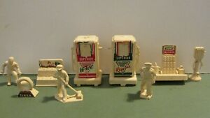 VINTAGE TOY SUPERIOR GAS PUMPS, OIL, BATTERY AND TIRE STANDS AND MORE BY T. COHN