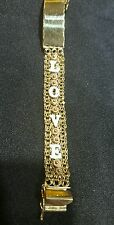 14k tricolor solid gold bracelet with love and a flower