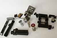 a lot of tripod heads and other accessories - as pictured