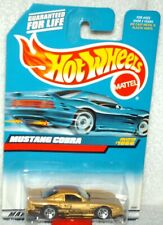 Hot Wheels 1999 #1066 Mustang Cobra gold,black int,ex.card