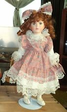 vintage collectible memories porcelain doll with two red apples in basket