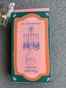 Oliver Bonas - Star Rotary Candle Holder